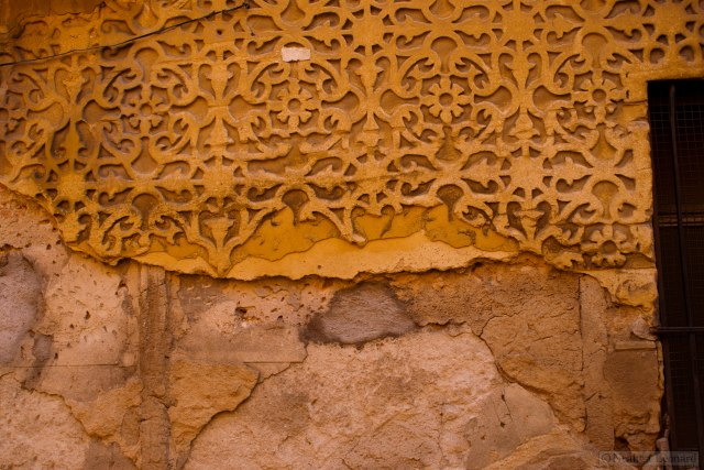 Old wall pattern, the material looks and feels like reconstituted sandstone.